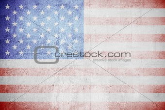 Shabby USA flag on a white wall