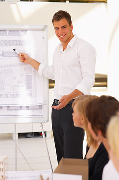 Architect making a presentation to colleagues - before retouching