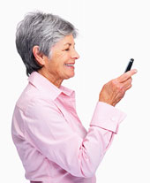 Happy senior woman reading text message