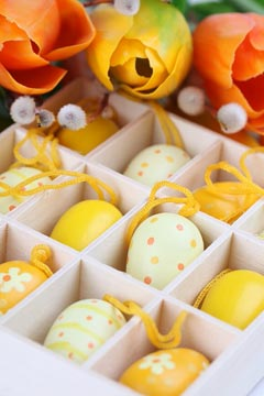 Yellow Easter eggs and tulips