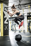 Jumping active woman in gym